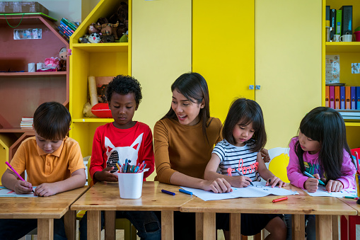 Child care teacher and children in a classroom