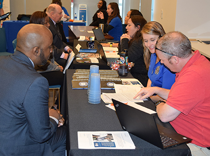 Job seekers talk to potential employers