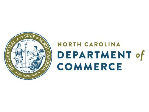 North Carolina State Seal with the words North Carolina Department of Commerce to the right of the seal