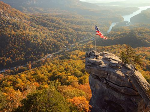 Aerial view of Chimney Rock and flag