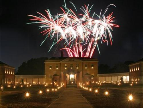 Fireworks at night above Tryon Palace