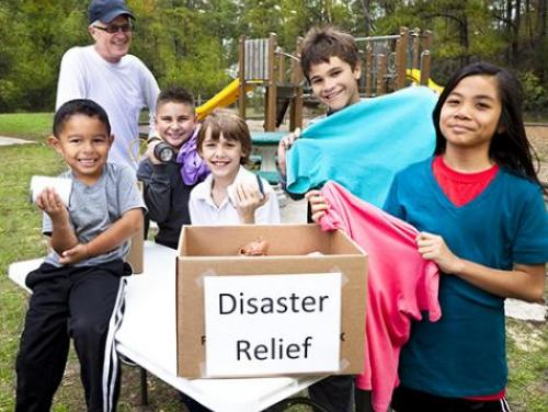 Children collecting donations for disaster relief victims