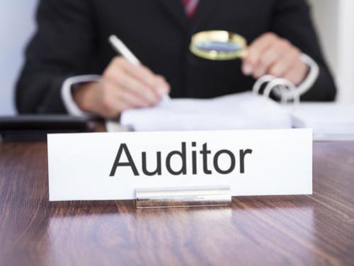 "Desk sign that says ""Auditor"""