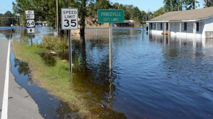 flooded property in Princeville following Hurricane Matthew