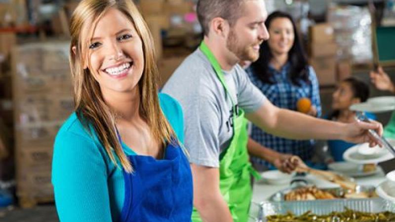 Volunteers serve food at soup kitchen