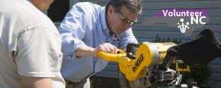 Governor Cooper operating a circular saw