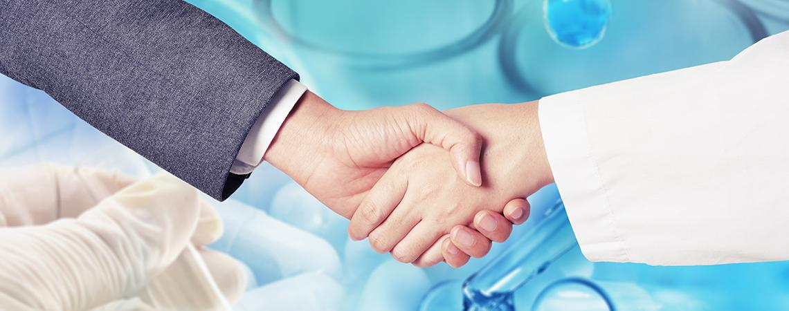 Businessperson and medical professional shaking hands
