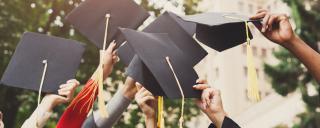 Graduation Caps are held in air