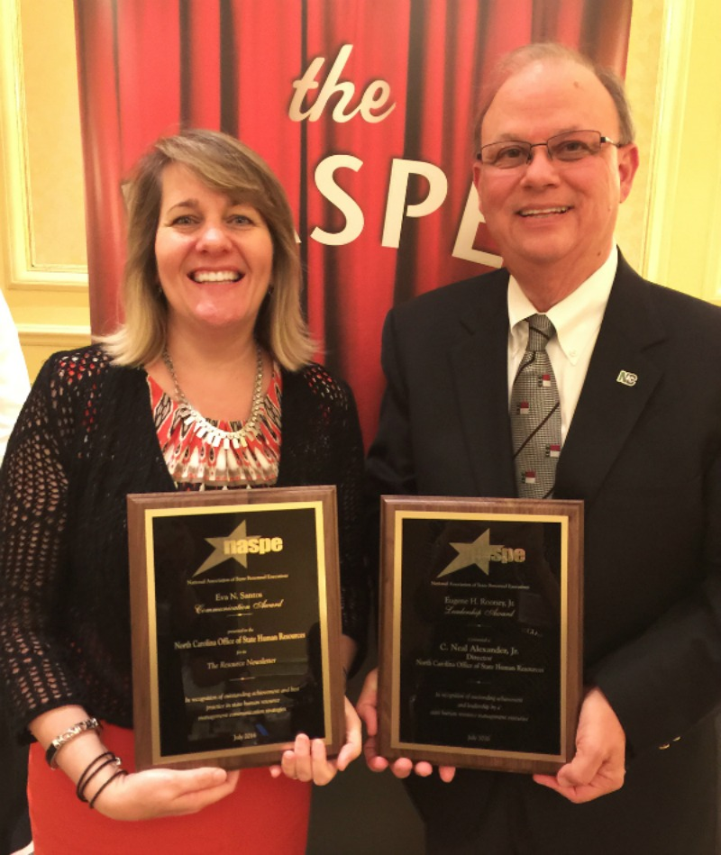 Paula Woodhouse and C. Neal Alexander, Jr. with award plaques