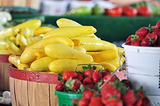 yellow squash and red strawberries
