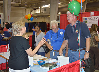 State workers talking to health fair participant