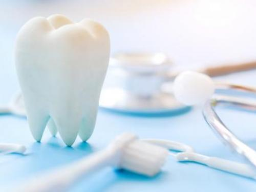 white tooth and dental instruments