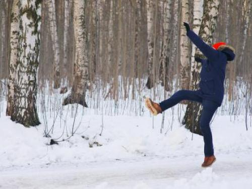 person slipping on snowy path