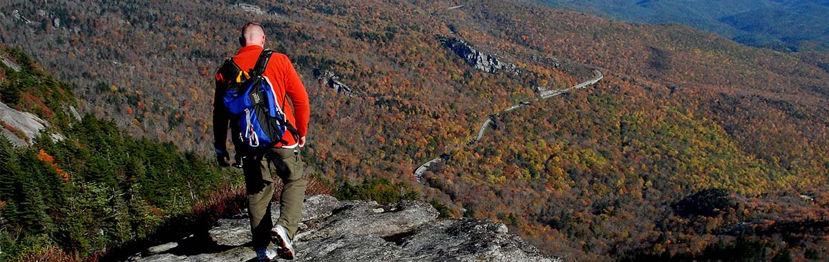 A hiker on a steep slope at Grandfather Mountain State Park