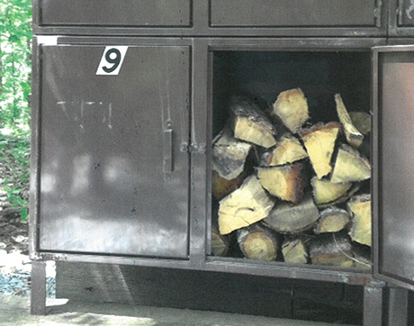 Wood locker showing firewood inside