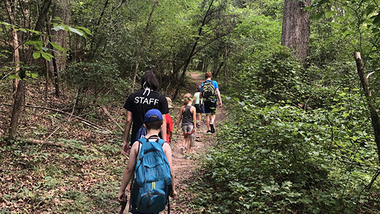 Young participants in the Forest Edge/Deep Forest program at Piedmont Wildlife Center hike with a group. Photo courtesy of the Piedmont Wildlife Center website.