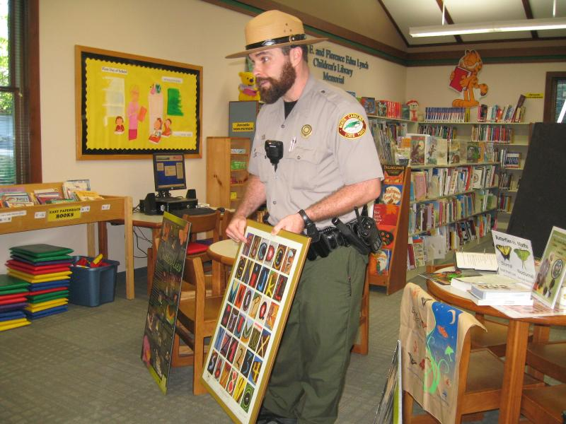 Ranger leading a library program