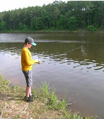 Kid fishing at the bank of Falls Lake State Recreation Area