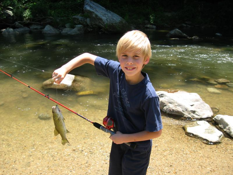 Grandchild catches a trout in Broad River