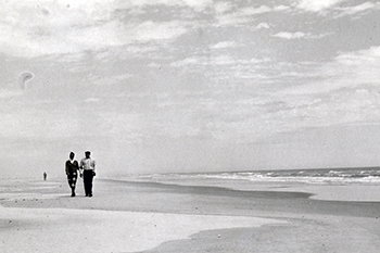 C. Payne Lucas and his wife strolling at Hammocks Beach, circa 1961. Photo from the North Carolina State Parks archives.