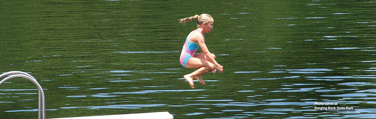 Jumping off the swim platform at Hanging Rock State Park lake