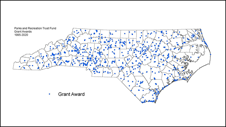 Map of North Carolina with counties delineated and blue dots representing NC PARTF grant recipients to date