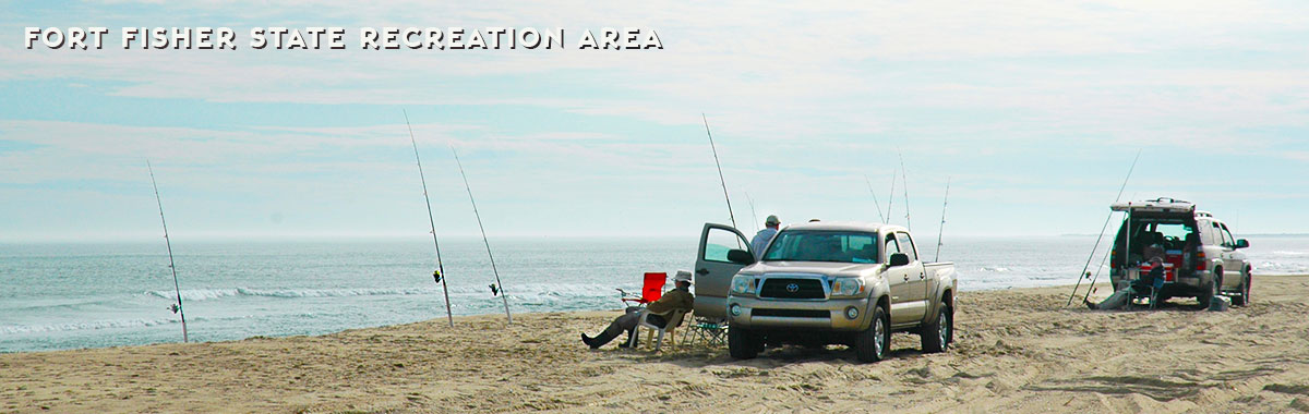 Fishermen relax on the beach at Fort Fisher