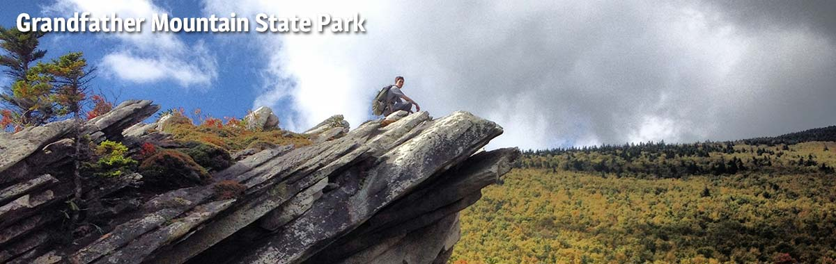 A hiker enjoys the view at Grandfather Mountain State Park