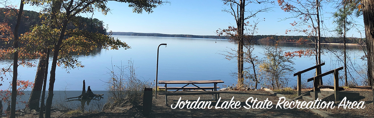 A campsite and view of Jordan Lake during the fall season