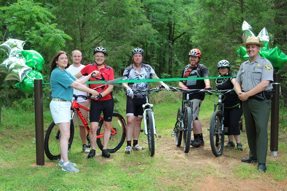 ceremonial ribbon cutting to open the newly constructed mountain bike trails