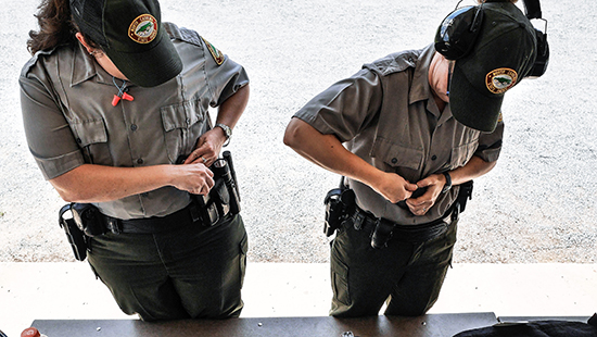 Two rangers prepare for firearms exercises at ranger training. Photo by C. Peek..