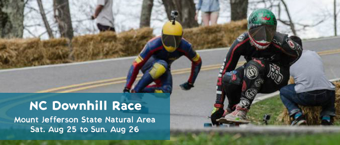 Skateboarders race down Mount Jefferson at the North Carolina Downhill Race