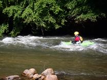 Kayaker on the play waves at the Dan River at Hanging Rock State Park. Photo by D. Cook.