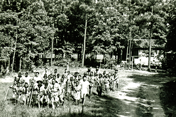 A Boy Scout troop exploring Reedy Creek at what is now William B. Umstead State Park, circa 1945. Photo from the North Carolina State Parks archives.