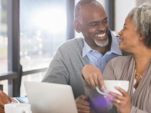 Smiling senior couple with laptop