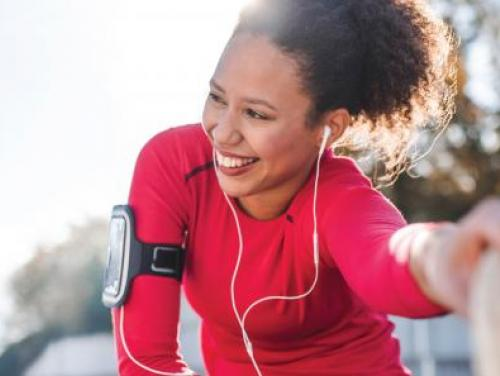 Smiling woman stretching before going on a run