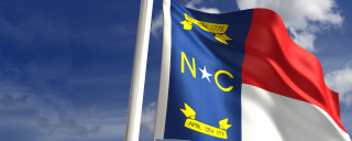 Image of the state of North Carolina flag blowing in the wind
