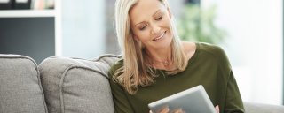 Image of a woman on a tablet browsing