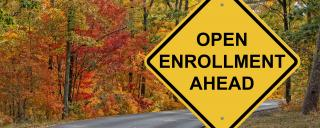 "A caution sign that reads ""Open Enrollment Ahead"""