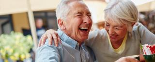 Mature couple laughing togehter