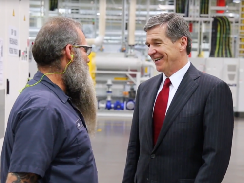 Governor Cooper speaks with worker