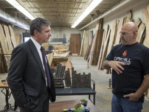 Governor Cooper speaks with Morganton crafstman