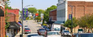 Main Street in downtown Mount Airy with shops and cars