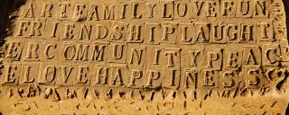 Inspirational words carved in clay