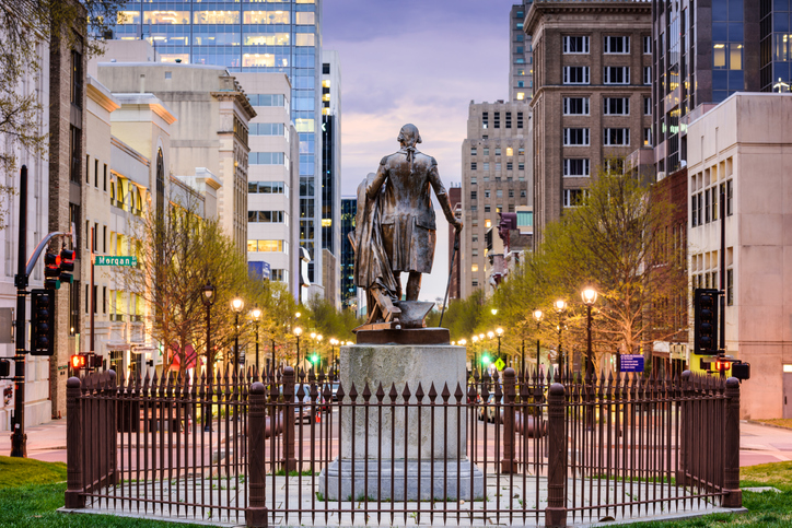 Photo of Christopher Columbus statue at the end of a street in downtown Raleigh