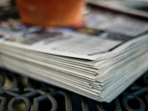 Photo of stack of newspapers