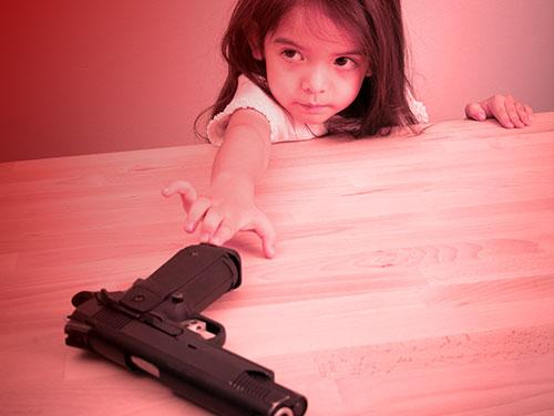 Child reaching for gun