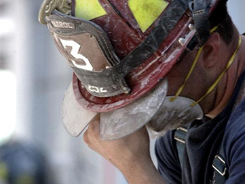 Firefighter with head down