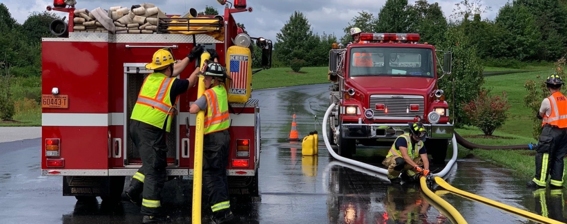 Firefighters inspecting hoses