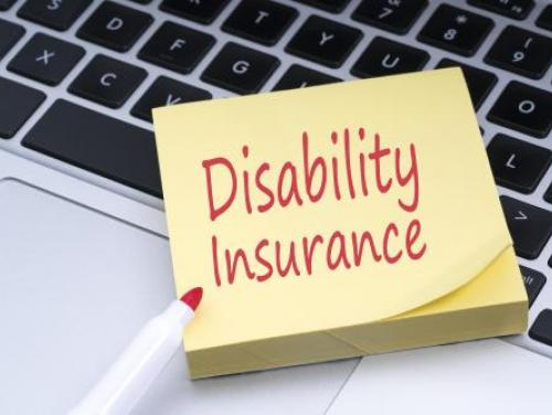 yellow sticky notepad with Disability Insurance written in red